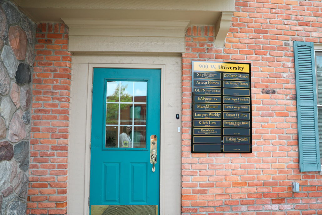 Exterior door and signage for the office of Nicole Parker, PhD, LMFT